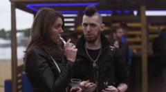 Man on street speak with woman smoke electronic cigarette. Vaper festival - stock footage