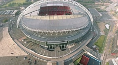 Flying Over And Looking Down at Wembley Stadium in London Aerial 4K UHD Footage Stock Footage
