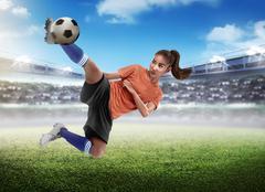 Asian woman football player kick ball Kuvituskuvat