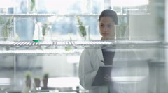 4K Research scientist & astronaut working together in laboratory Stock Footage
