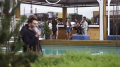 People smoking electronic cigarette at swimming pool. Vaper festival. Subculture Stock Footage
