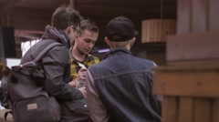 Young men smoking electronic cigarette on street. Vapers. Subculture. Friends - stock footage