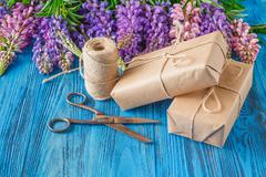 making present box wooden background - stock photo