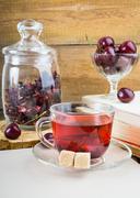 Red hibiscus tea and cherries Stock Photos