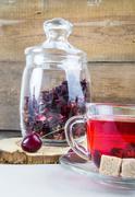 Red hibiscus tea and cherries - stock photo