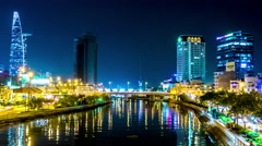 View of the river and the skyline in Ho Chi Minh City at night Stock Footage