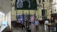WS stabilized pan from ceiling to interior view Saigon Post office Stock Footage