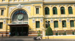 Stabilized WS (front view) pan from sidewalk to exterior Saigon Post office Stock Footage