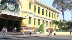 Stabilized wide shot pan from busy street to front of Saigon Post office Stock Footage