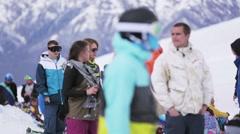 Crowd of people in encamp. Ski resort. Cameraman. Girl dance. Snowy slopes. Sun - stock footage