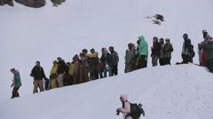 Snowboarders stay at slope. Snowy mountains. Adrenaline. Ski resort. Watchers - stock footage