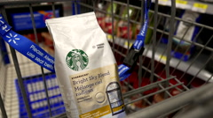 Woman buying Starbucks via instant coffee and putting into shopping cart Stock Footage