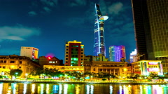 Night view of the river and the Bitexco tower in Ho Chi Minh City Stock Footage