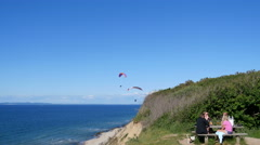 Paragliders having good wind when paragliding from a cliff - stock footage