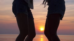 Happy Sexy Girls Dancing at Sunset Beach. Slow Motion. - stock footage