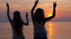 Young Hippie Women Dancing at Sunset on Beach on Vacation Stock Footage