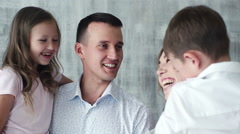 Close up portrait happy caucasian family wearing casual clothes laughing indoors Stock Footage