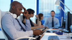 4K Bored corporate business team in office passing time by chatting Stock Footage