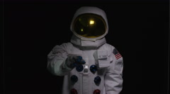 4K Astronaut using interactive touch screen on black background Stock Footage