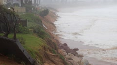 Extreme stormy gale force weather, beach houses, ocean waves Stock Footage