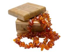 Wooden box with amber necklace Stock Photos