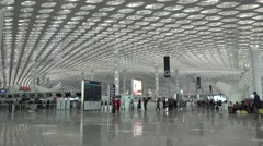 Shenzhen airport,waiting hall for airplanes,check-in counter,crowded people Stock Footage