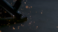 Slow motion close up of sparks raining onto the floor in an auto garage. Stock Footage