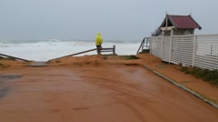 Watching waves during storm event threatening beach properties Stock Footage