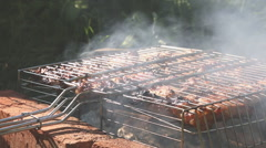 Grilled beef steak on the grilling pan outdoors Stock Footage