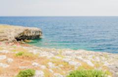 Defocused background with beautiful seascape in Salento, Apulia, Italy Stock Photos