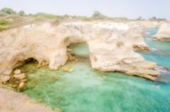 Defocused background with scenic rocky cliffs in Salento, Italy Stock Photos