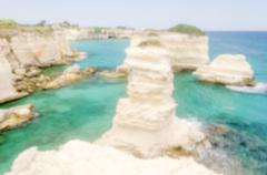 Defocused background with scenic rocky cliffs in Salento, Italy - stock photo