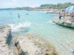 Defocused background of Baia dei Turchi beach in Salento, Italy - stock photo