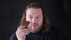 Man Biting With Relish A Piece Of Spare Ribs Stock Footage