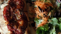 Calzone and salad for 	lunch - stock footage