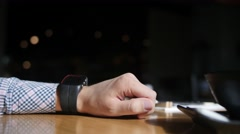 Caucasian man adjusting his smart watch. Close up of hands Stock Footage