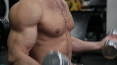Hands of bodybuilder working with weights in the gym Stock Footage