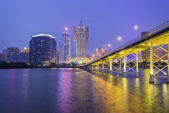 Building and the skyline of Macau city at night - stock photo
