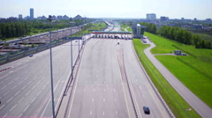 Aerial view of highway with Cars at modern toll road turnpike, entry fee pay - stock footage