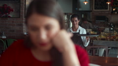 Waitress serving coffee to customer. - stock footage