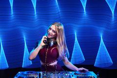 DJ girl on decks at the party Stock Photos