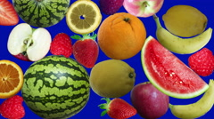 falling fruits on background blue screen - stock footage