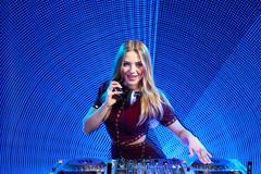 DJ girl on decks at the party Kuvituskuvat