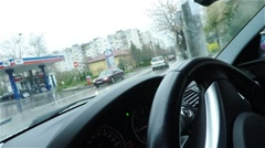 Car Driving  in Small Town on a Rainy day Stock Footage