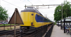 Public transport in the Netherlands, passenger train leaving train station, 4K Stock Footage