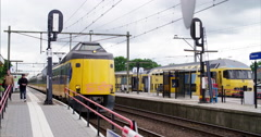 Public transport Netherlands and Europe, passenger train leaving train station Stock Footage