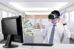 Male worker earns money with computer - stock photo