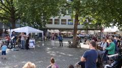 4k Street music event panning city centre Braunschweig Stock Footage