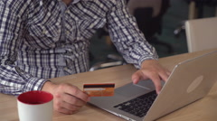 Online banking detail. Man buying via internet using credit card and computer Stock Footage