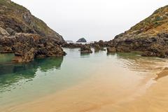 Beach with Rocks Stock Photos